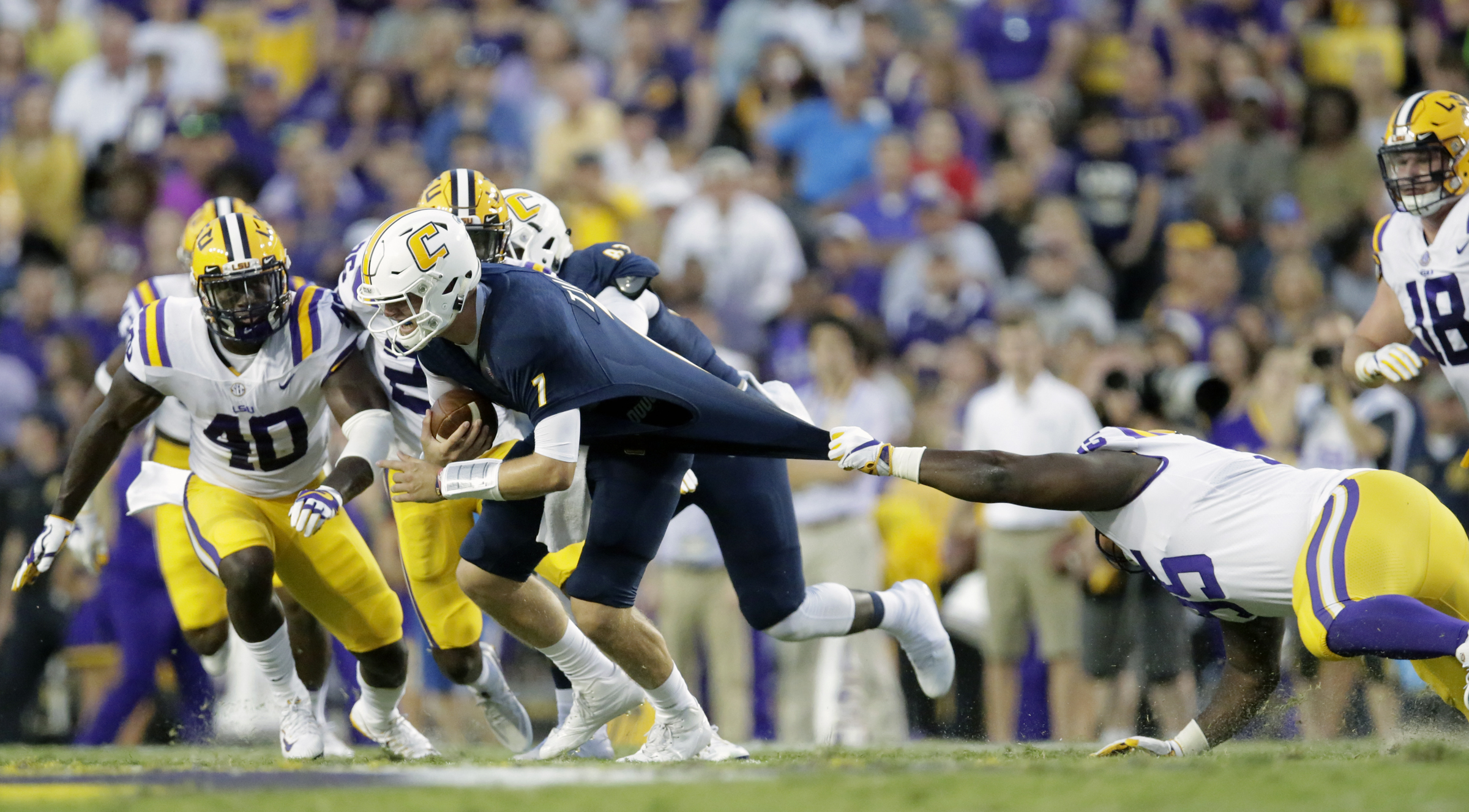 LSU Tigers Ed Alexander (95) pulls on the jersey of Chattanooga Mocs quarterback Nick Tiano (7) during first half action in Baton Rouge on Saturday, September 9, 2017. (Photo by Brett Duke, Nola.com | The Times-Picayune)
