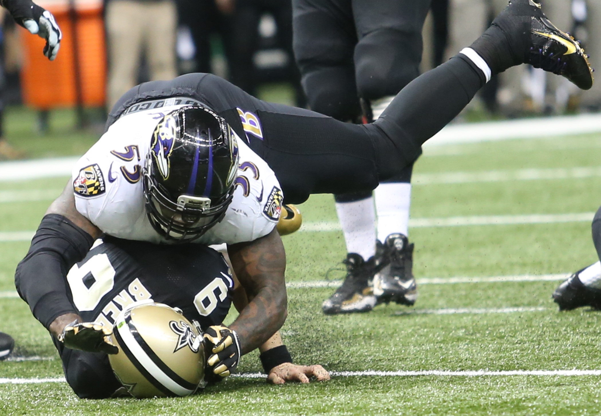 New Orleans Saints quarterback Drew Brees (9) is driven into the ground on a scramble by Baltimore Ravens outside linebacker Terrell Suggs (55) during the game between the Baltimore Ravens and New Orleans Saints at the Superdome on Monday, November 24, 2014. (Michael DeMocker, Nola.com / The Times-Picayune)