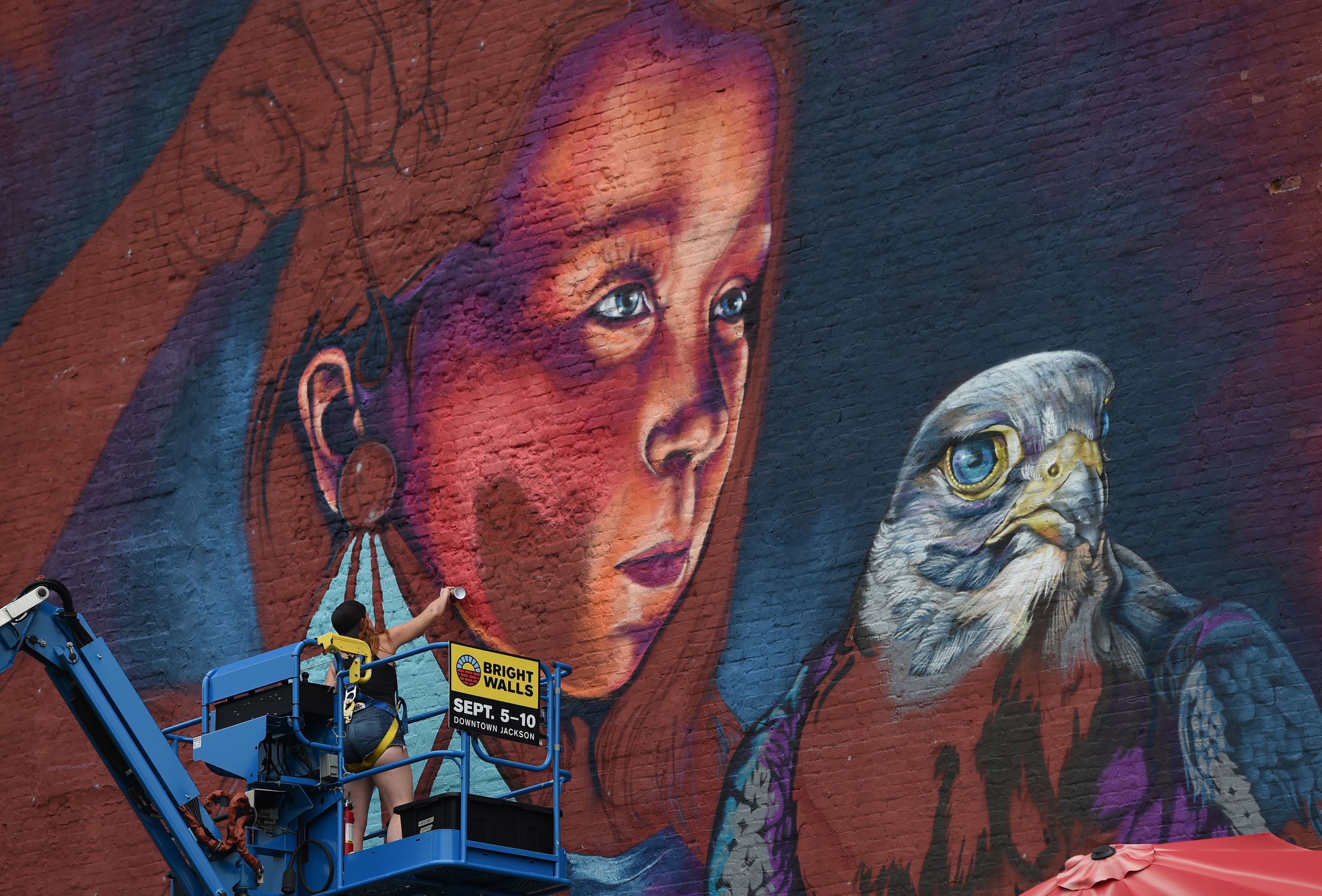 Downtown Jackson mural underway, previewing 2019 Bright Walls festival
