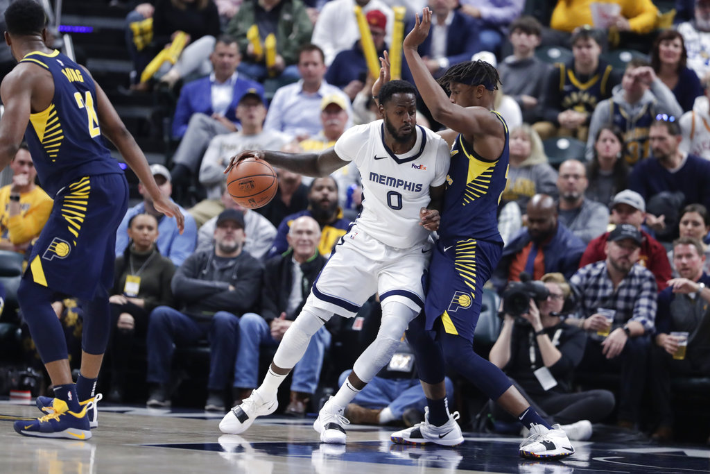 Memphis Grizzlies forward JaMychal Green dribbles against Indiana Pacers forward Myles Turner during an NBA game on Wednesday, Oct. 17, 2018, in Indianapolis.