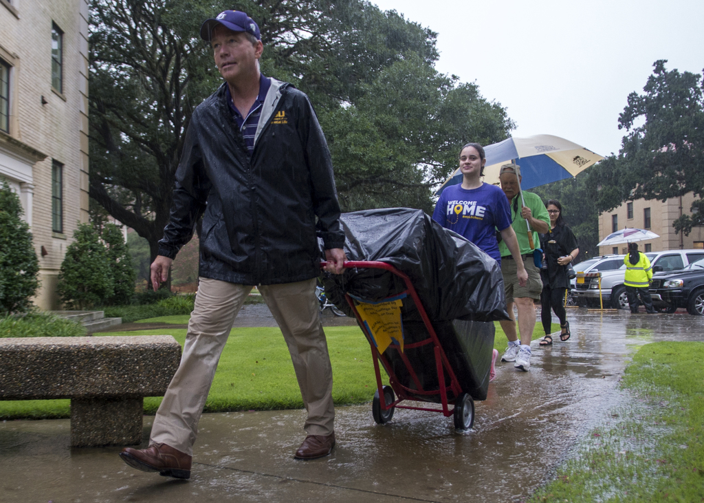 LSU President F. King Alexander helped students and their families move into their on-campus residential halls on LSU Move-In Day on Aug. 19, 2015.