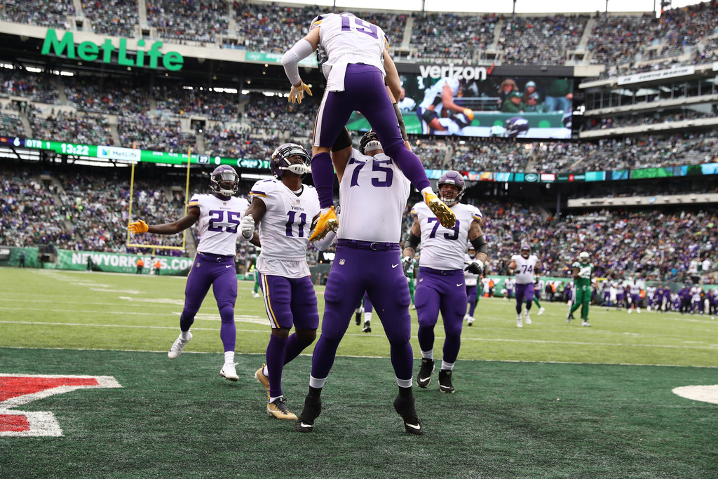 EAST RUTHERFORD, NJ - OCTOBER 21: Adam Thielen #19 of the Minnesota Vikings celebrates his first quarter touchdown with Brian O'Neill #75 against the New York Jets during their game at MetLife Stadium on October 21, 2018 in East Rutherford, New Jersey. (Photo by Al Bello/Getty Images) Getty Images