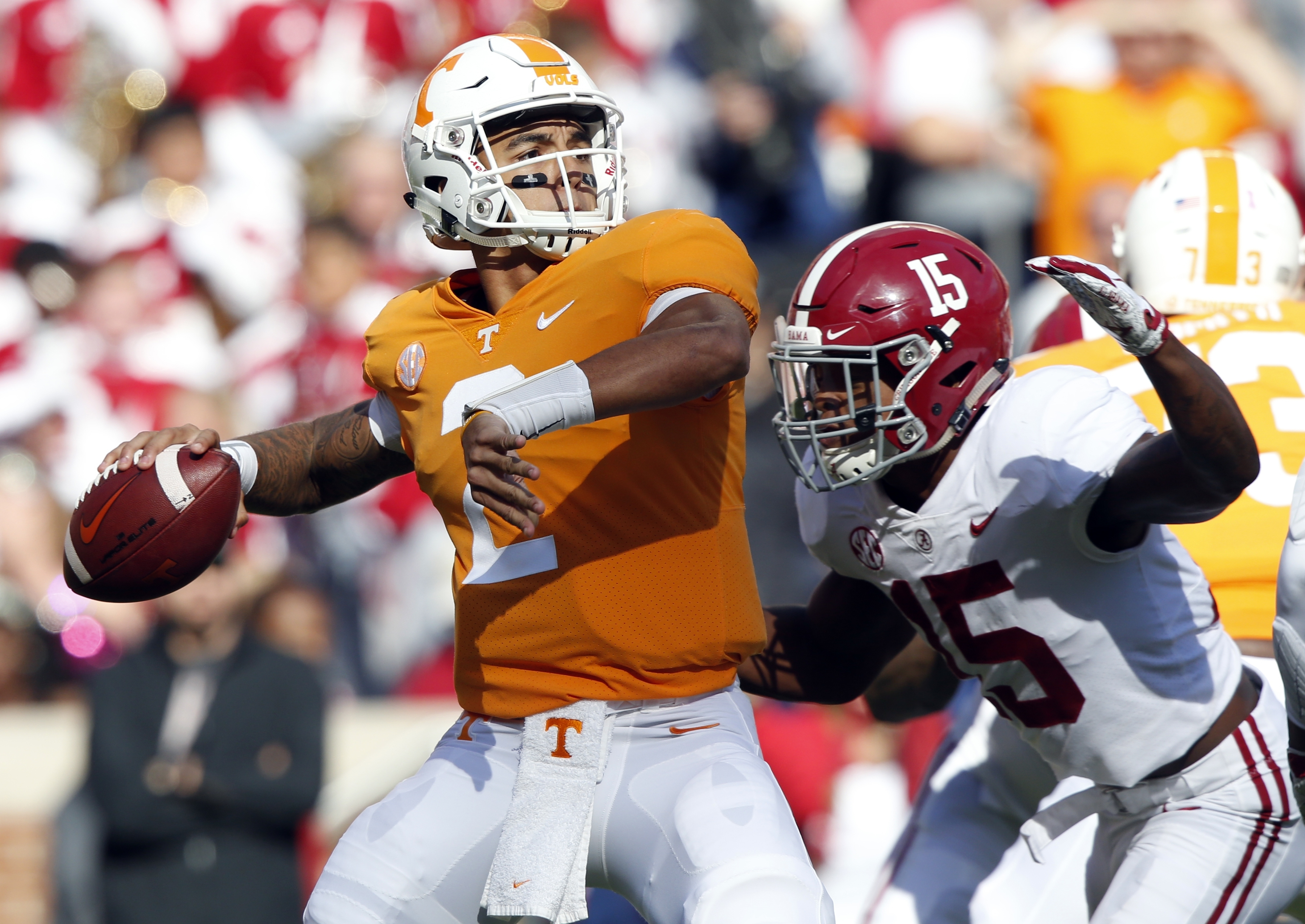 Tennessee quarterback Jarrett Guarantano (2) attempts to throw to a receiver as he is pressured by Alabama defensive back Xavier McKinney (15) in the first half against Alabama Saturday in Knoxville, Tenn.