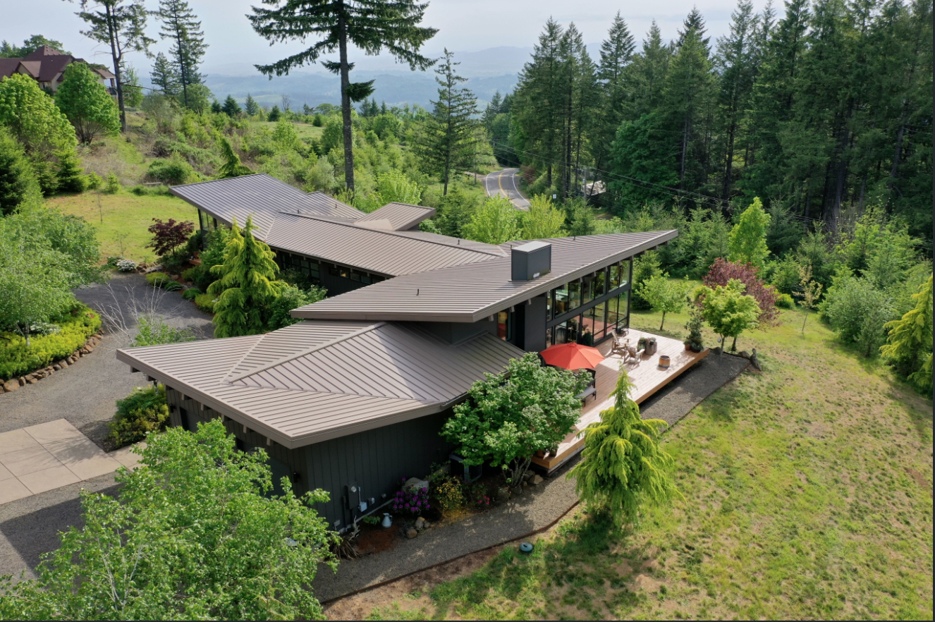 A cool contemporary dwelling in Yamhill County has a wine cellar that leads to a moody speakeasy