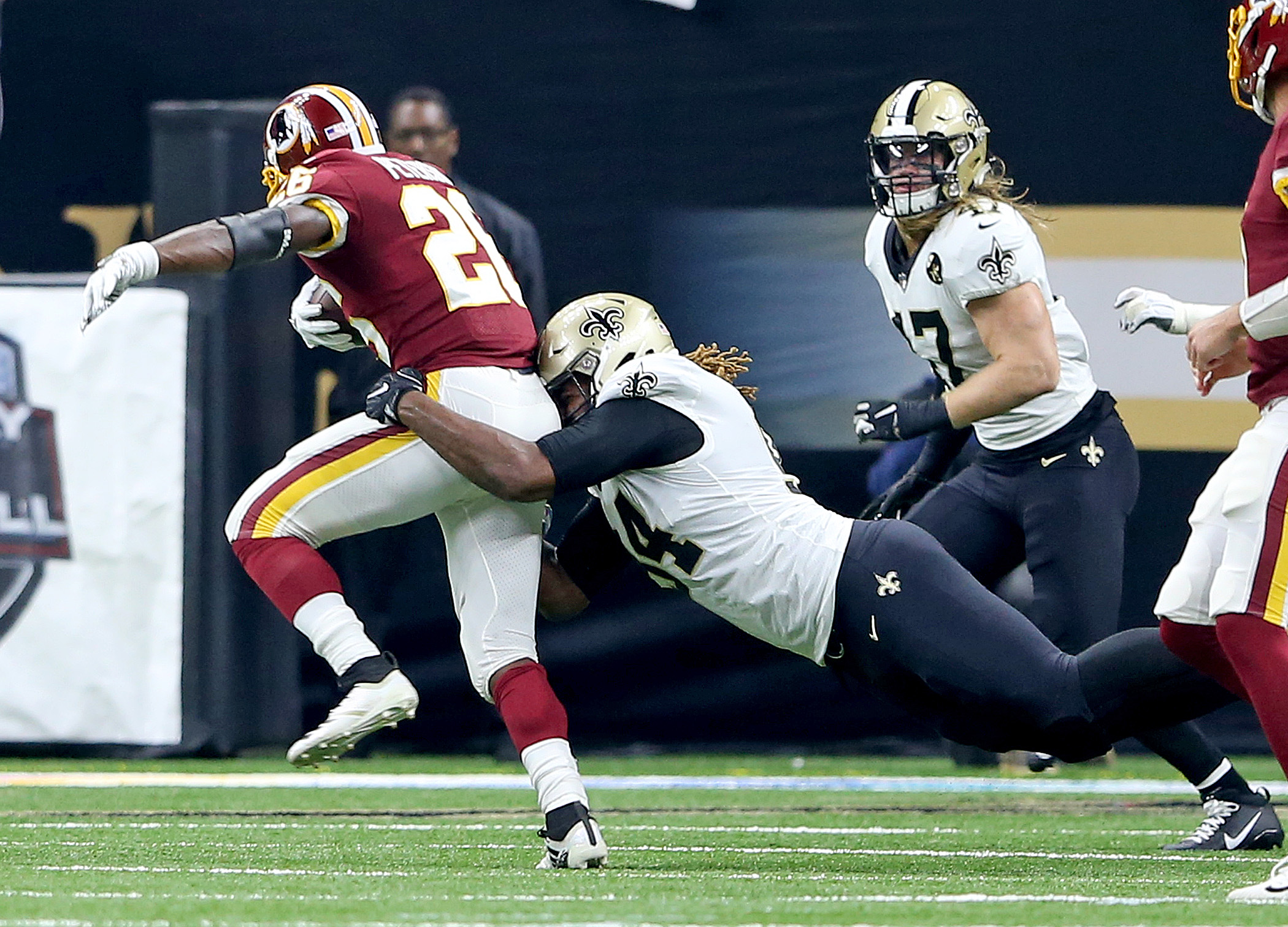 New Orleans Saints defensive end Cameron Jordan tackles Washington Redskins running back Adrian Peterson at the Superdome on Monday, October 8, 2018. (Photo by Michael DeMocker, NOLA.com | The Times-Picayune)
