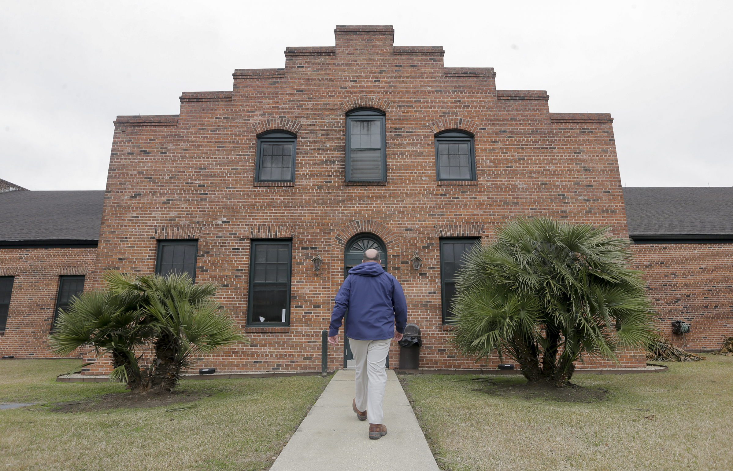 McIlhenny Co. executive Harold Osborn walks to the Tabasco plant on Avery Island on Jan. 9. Louisiana's Avery Island, a salt dome and the birthplace of Tabasco sauce, is newly listed on the National Register of Historic Places.