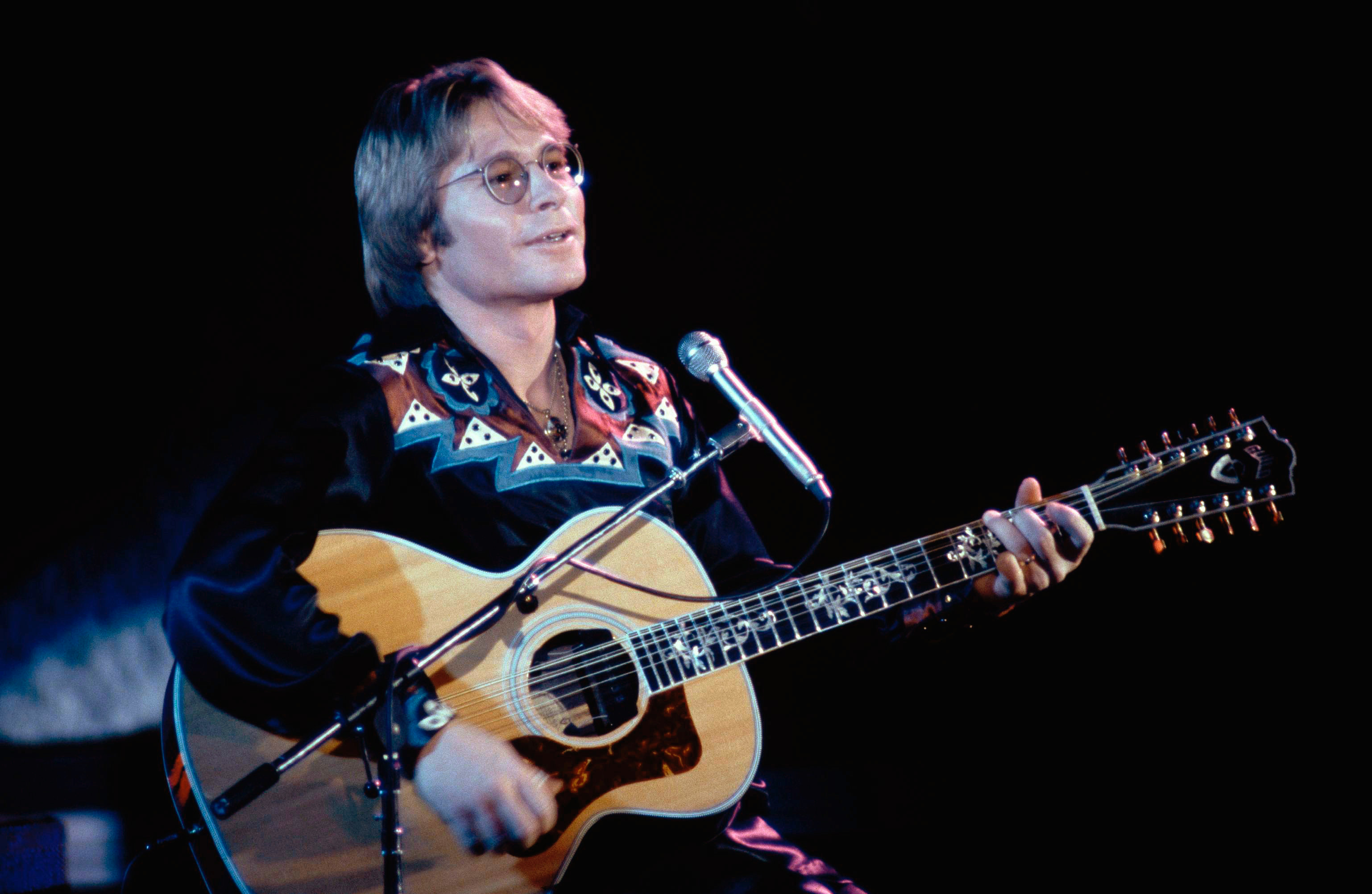 What were John Denver's biggest hits?