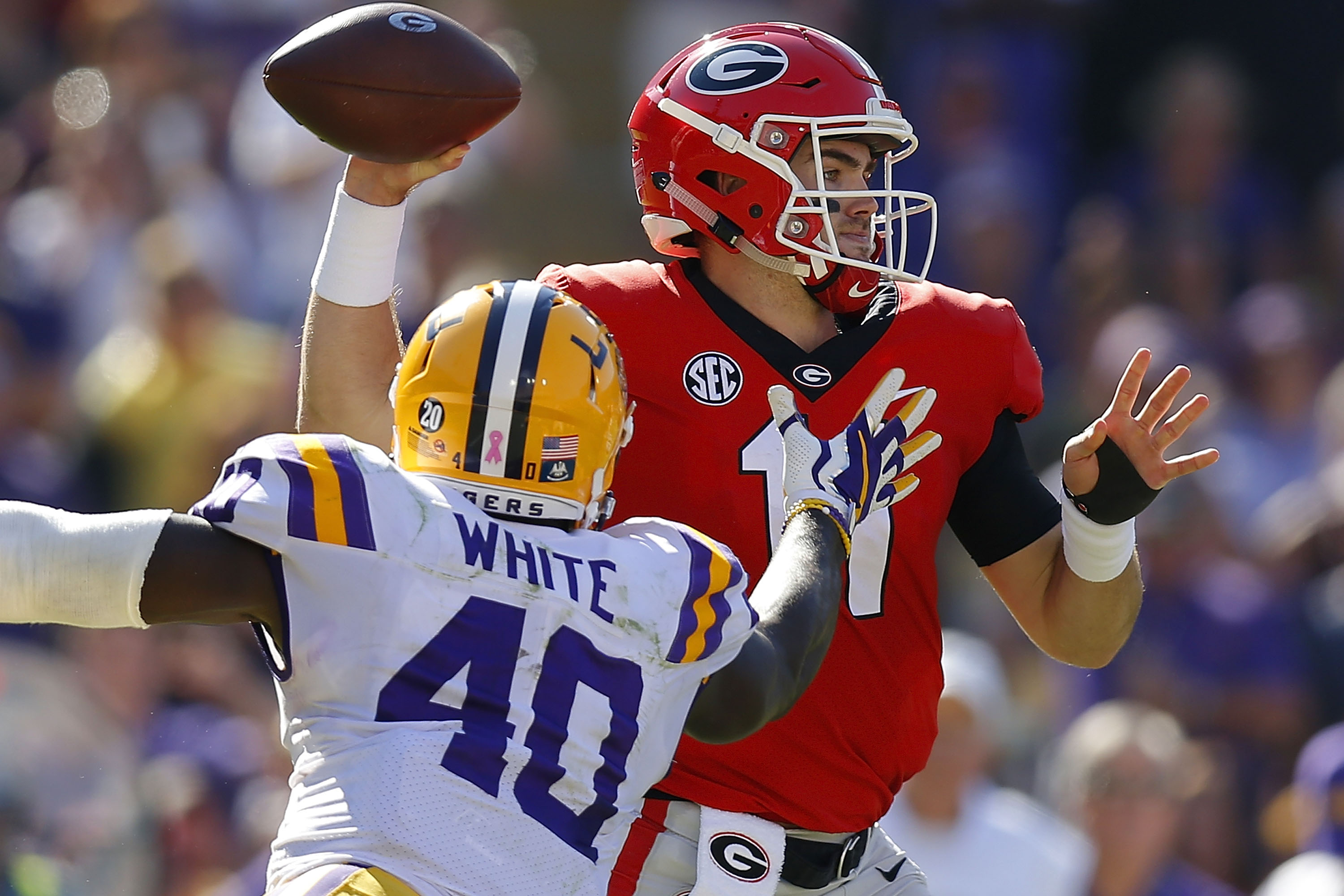 BATON ROUGE, LA - OCTOBER 13: Jake Fromm #11 of the Georgia Bulldogs throws the ball as Devin White #40 of the LSU Tigers defends during the first half at Tiger Stadium on October 13, 2018 in Baton Rouge, Louisiana. (Photo by Jonathan Bachman/Getty Images) Getty Images