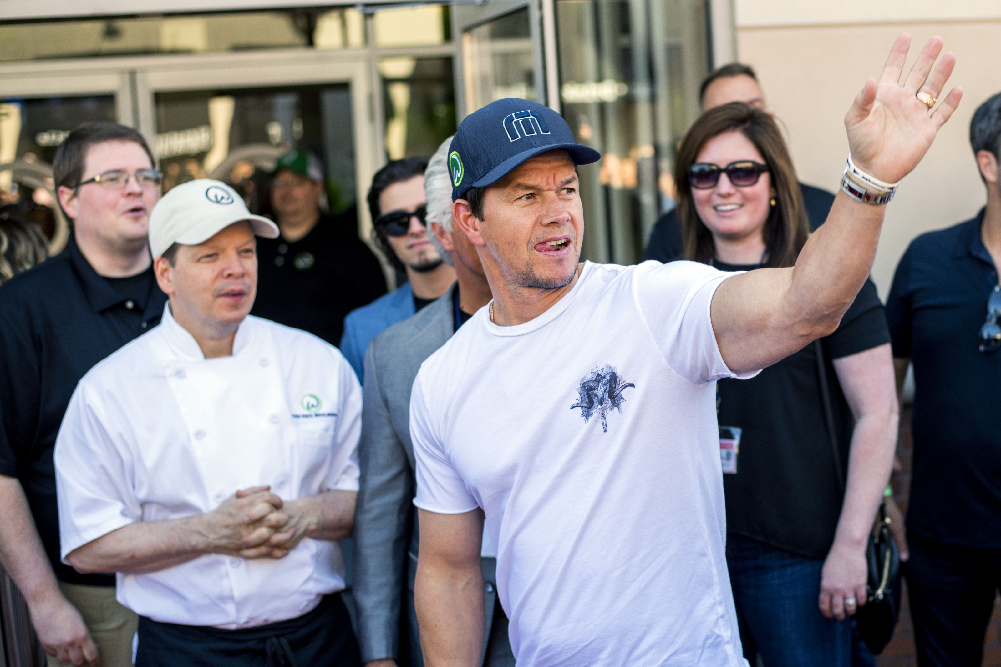 Corset signed by Wahlberg brothers raises $12,500 for breast cancer patients