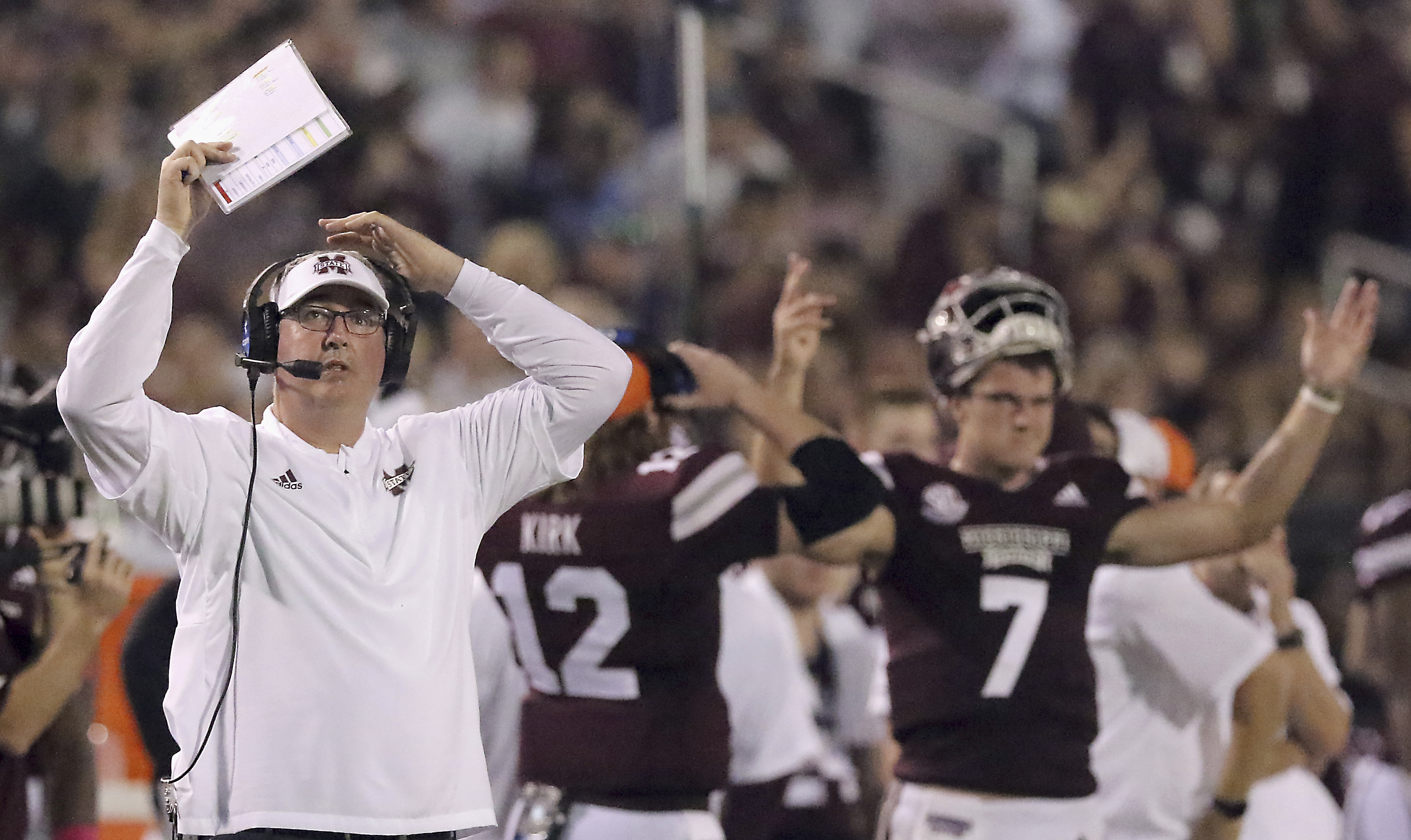 Mississippi State head coach Joe Moorhead, left and quarterback Nick Fitzgerald (7) both react to the replay on the video board while game officials reviewed the play making sure Fitzgerald had indeed crossed the goal line and scored a touchdown during the first half of their game against Auburn on Oct. 6, 2018, in Starkville, Miss. (AP Photo/Jim Lyle)
