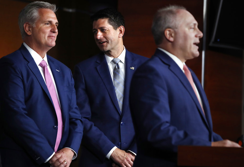 In this Sept. 13, 2018 file photo, House Speaker Paul Ryan of Wis., center, talks with House Majority Leader Kevin McCarthy of Calif., left, while House Majority Whip Steve Scalise, R-La., speaks during a news conference in Washington. As Ryan bows out of Congress, he leaves no obvious heir apparent. House Republicans are scrambling to salvage their majority but also confronting a potentially messy GOP leadership battle regardless of which party controls the chamber after the November election.