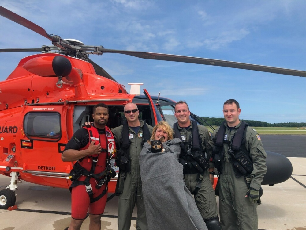 Couple and 3 dogs stuck overnight along Lake Michigan bluff, rescued by Coast Guard