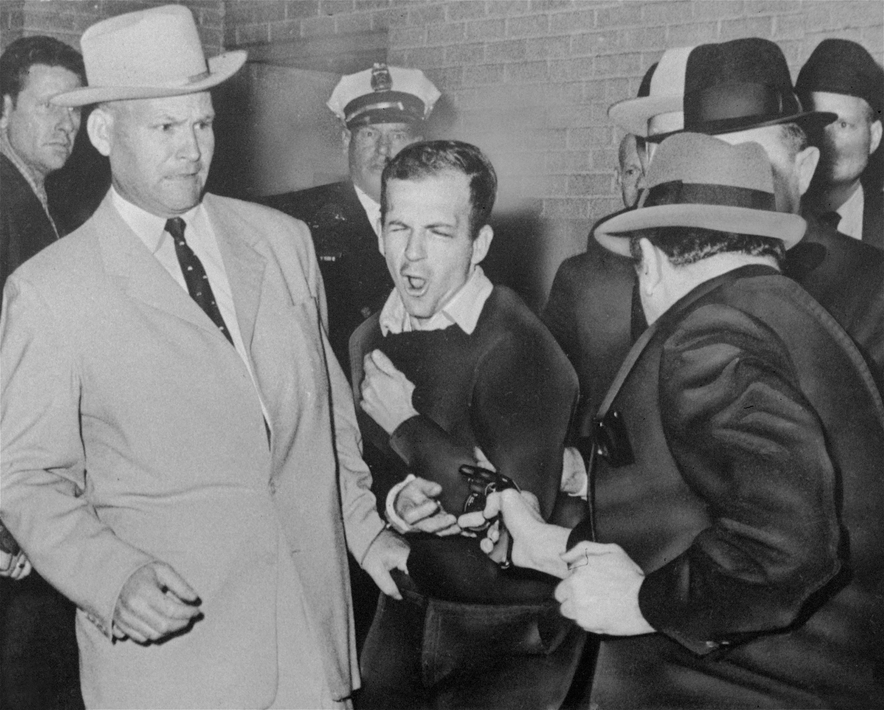 Detective who was handcuffed to Lee Harvey Oswald dies at 99