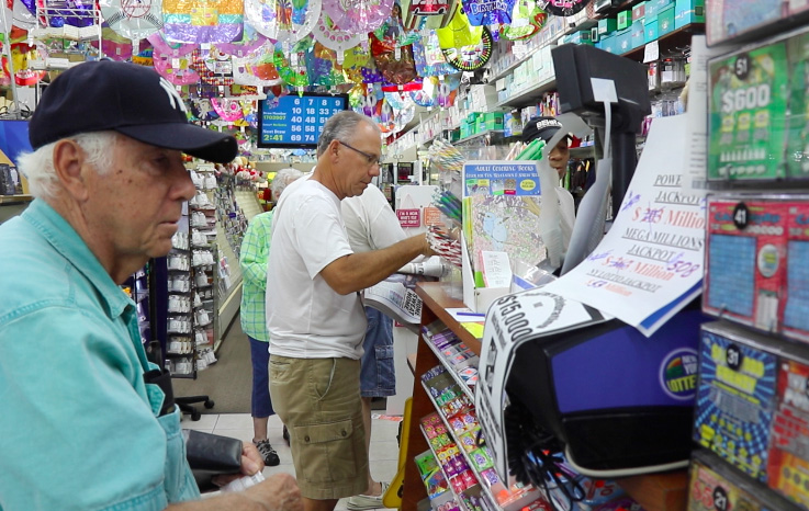 This 2016 file photo shows customers buying lottery tickets at the Tysen & Hylan Cards & Gifts in New Dorp. (Staten Island Advance)