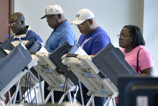 Citizens cast their ballots during early voting at the Municipal Building in Augusta, Ga., Monday, Oct. 15, 2018. Early voting for the midterm elections in Georgia started today. (Michael Holahan/The Augusta Chronicle via AP)