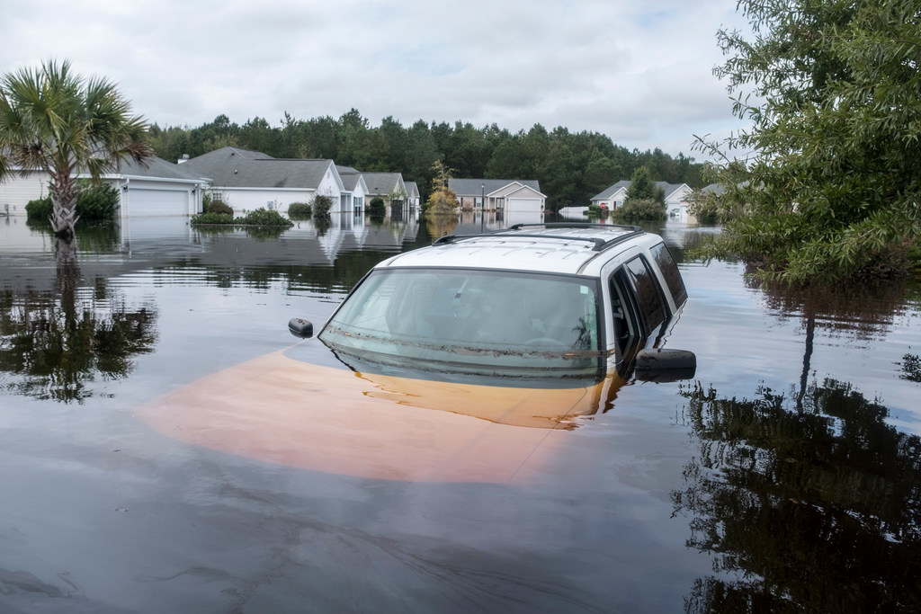 The Polo Farms neighborhood off S.C. 905 is largely underwater, on Monday, Sept. 24, 2018, in Longs, S.C., due to Hurricane Florence's deluge. Scientists said the storm dumped 50 percent more rain due to climate change and flooded 11,000 additional homes due to sea level rise.