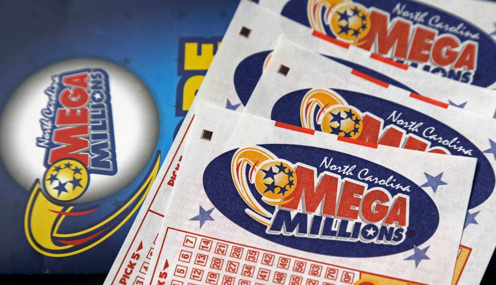 This July 1, 2016, file photo shows Mega Millions lottery tickets on a counter at a Pilot travel center near Burlington, N.C. After nearly three months without a winner, the Mega Millions lottery game has climbed to an estimated $654 million jackpot.