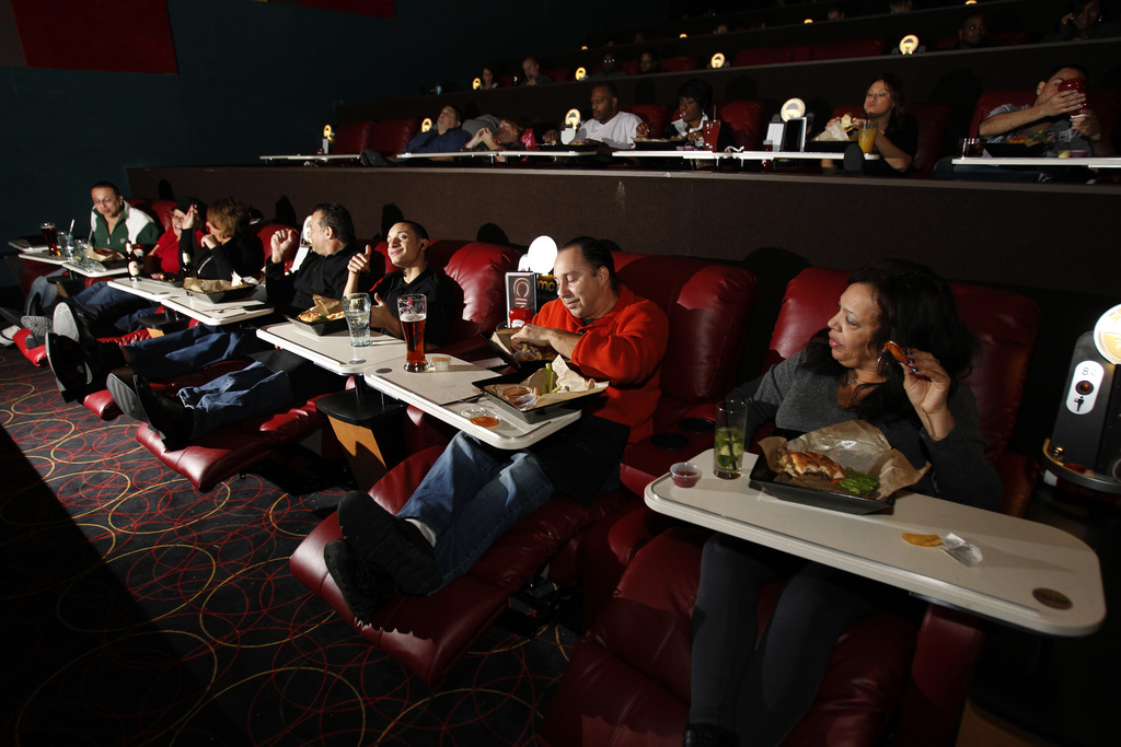 The Cosme family from West Orange dine in their luxury recliners at Cinema Suites at the AMC theatre in West Orange. The new AMC Theatre opening in the Staten Island Mall will offer dine-in options. (Tim Farrell/The Star-Ledger)