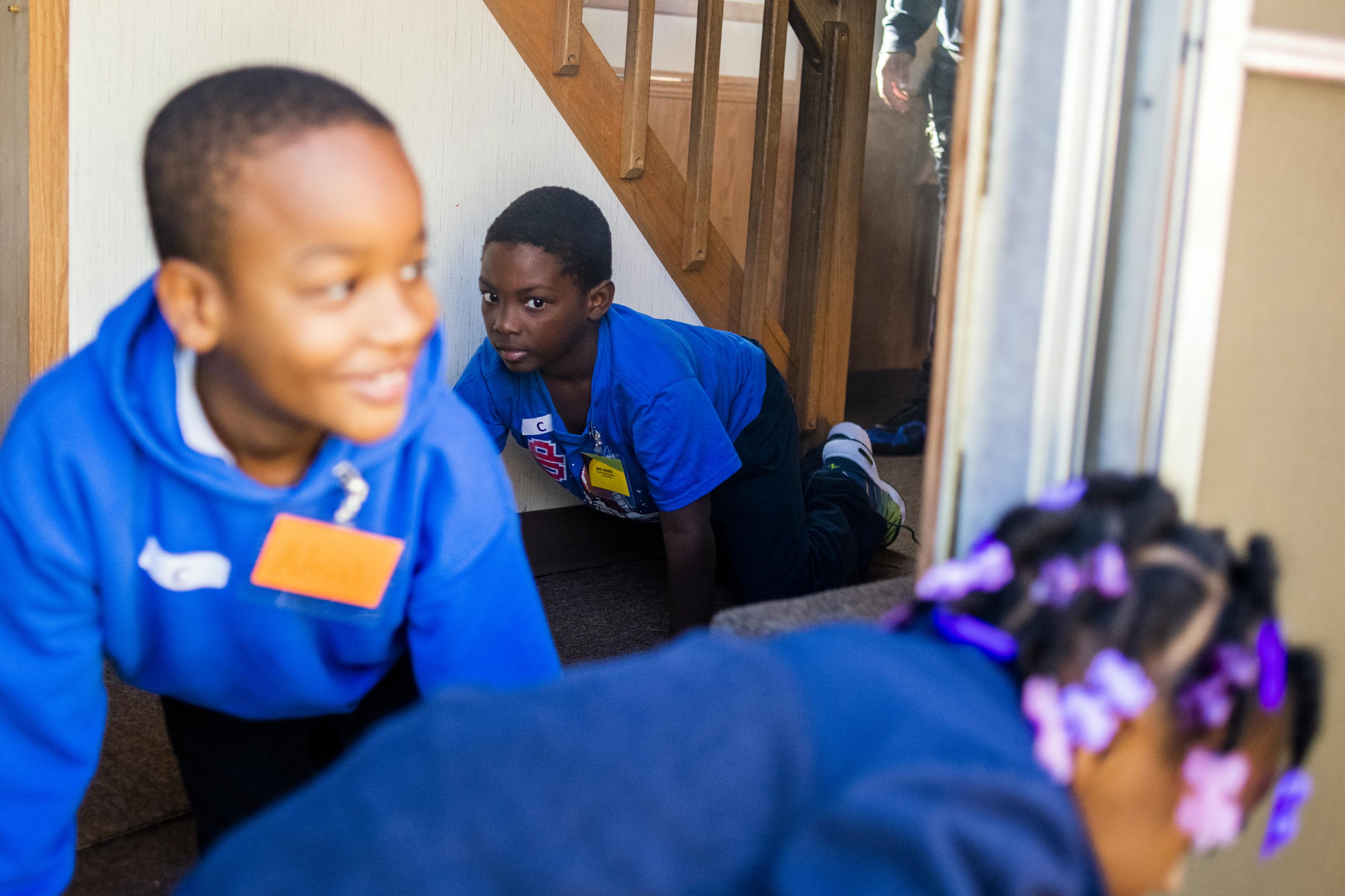 Flint firefighters train first-graders in fire prevention