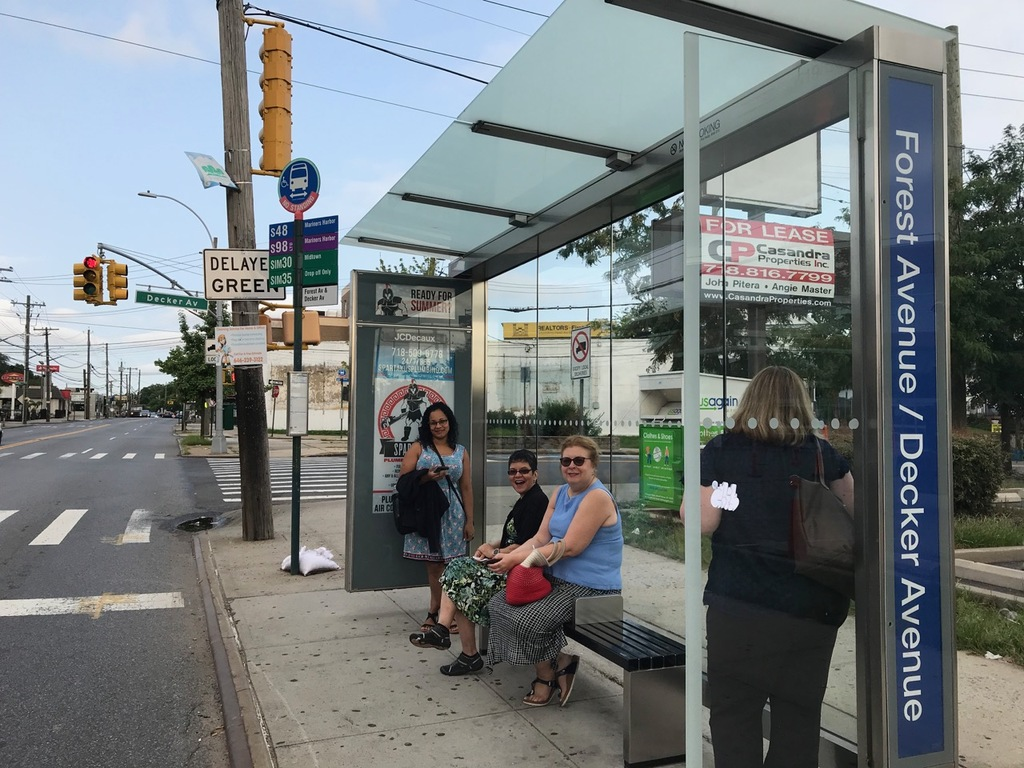 Commuters wait for the SIM30 bus at the Forest and Decker avenues bus stop. (Staten Island Advance/Annalise Knudson)