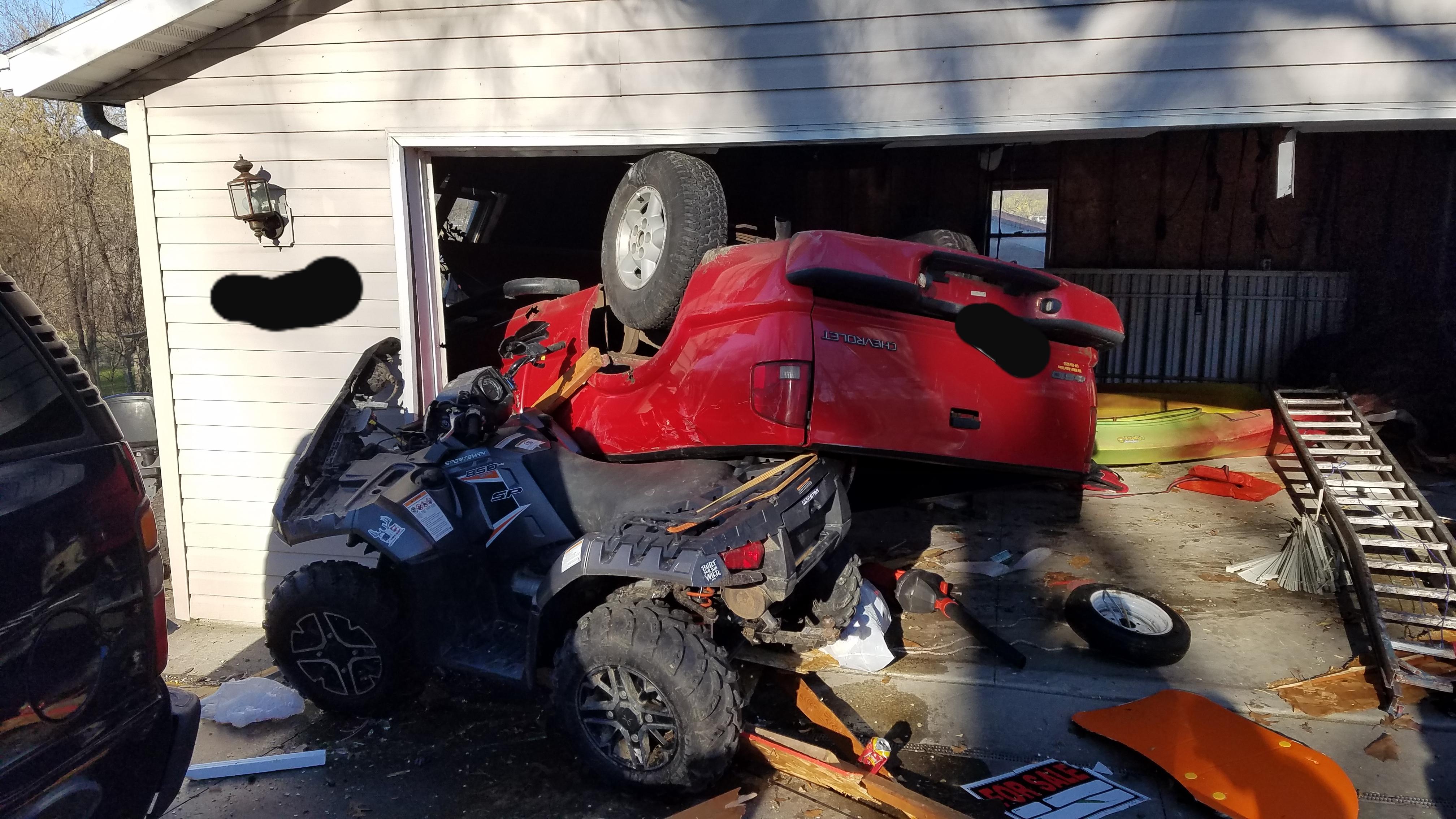 Man drives truck through detached garage, homeowner injured