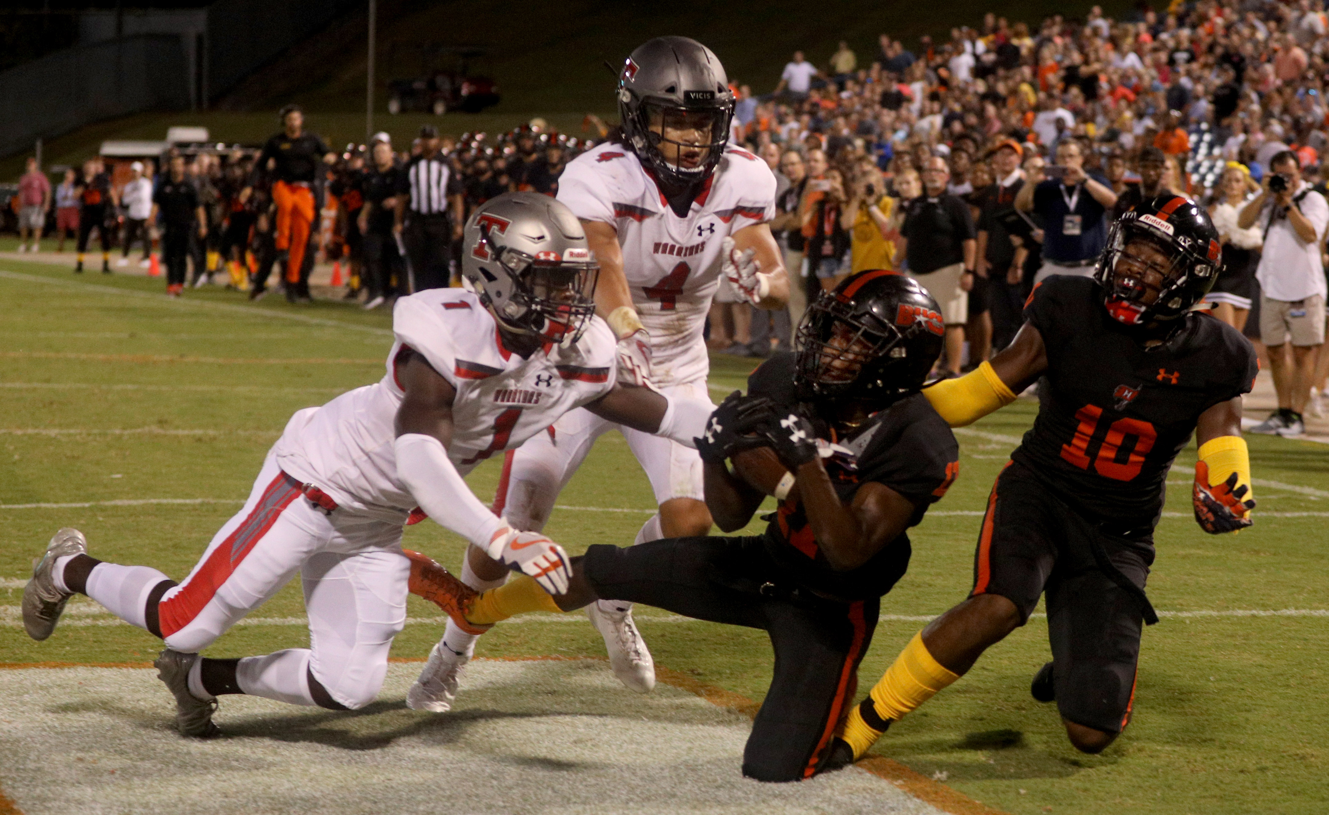Hoover's Xavier Long catches a touchdown pass as Thompson's Sam Reynolds, left, and Jalen Bustamante defend during a high school football game at the Hoover Met in Hoover, Ala., Friday, Sept. 7, 2018. (Dennis Victory/preps@al.com) Dennis Victory