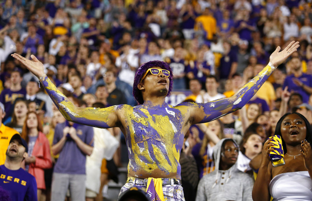 A fan cheers from the crowd during an NCAA college football game between LSU and Mississippi State in Baton Rouge, La., Saturday, Oct. 20, 2018. LSU won 19-3. (AP Photo/Tyler Kaufman)