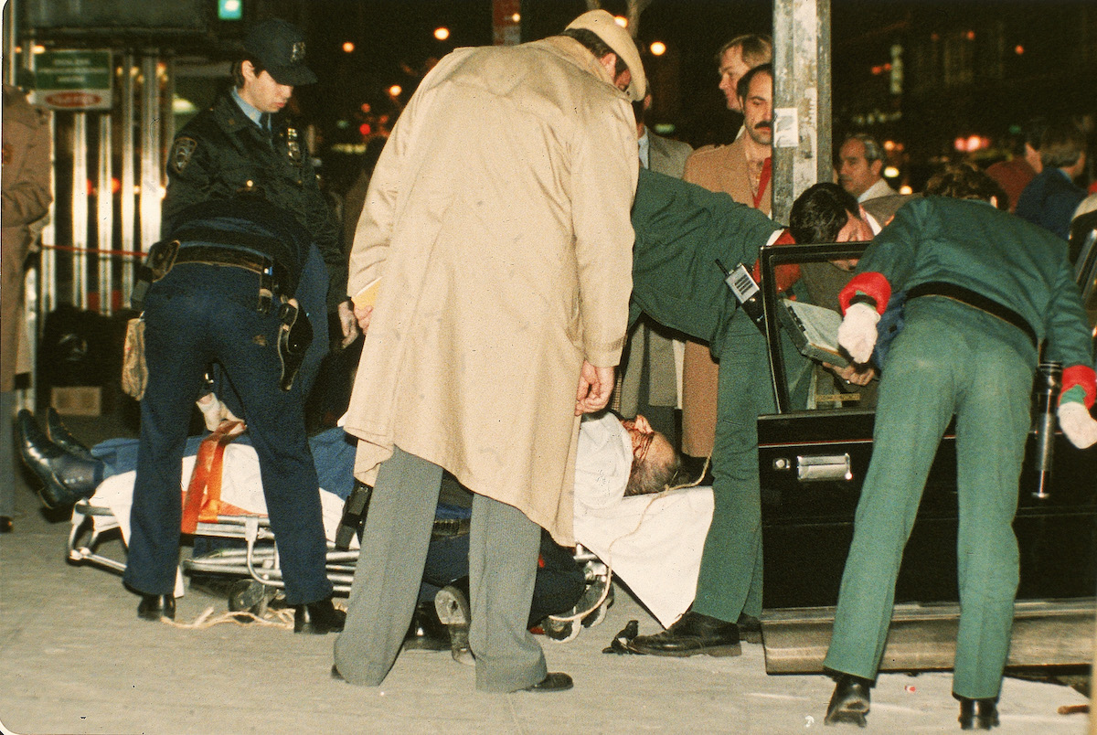 The body of mafia crime boss Paul Castellano lies on a stretcher outside the Sparks Steak House in New York after he and his bodyguard were gunned down Dec. 16 1985
