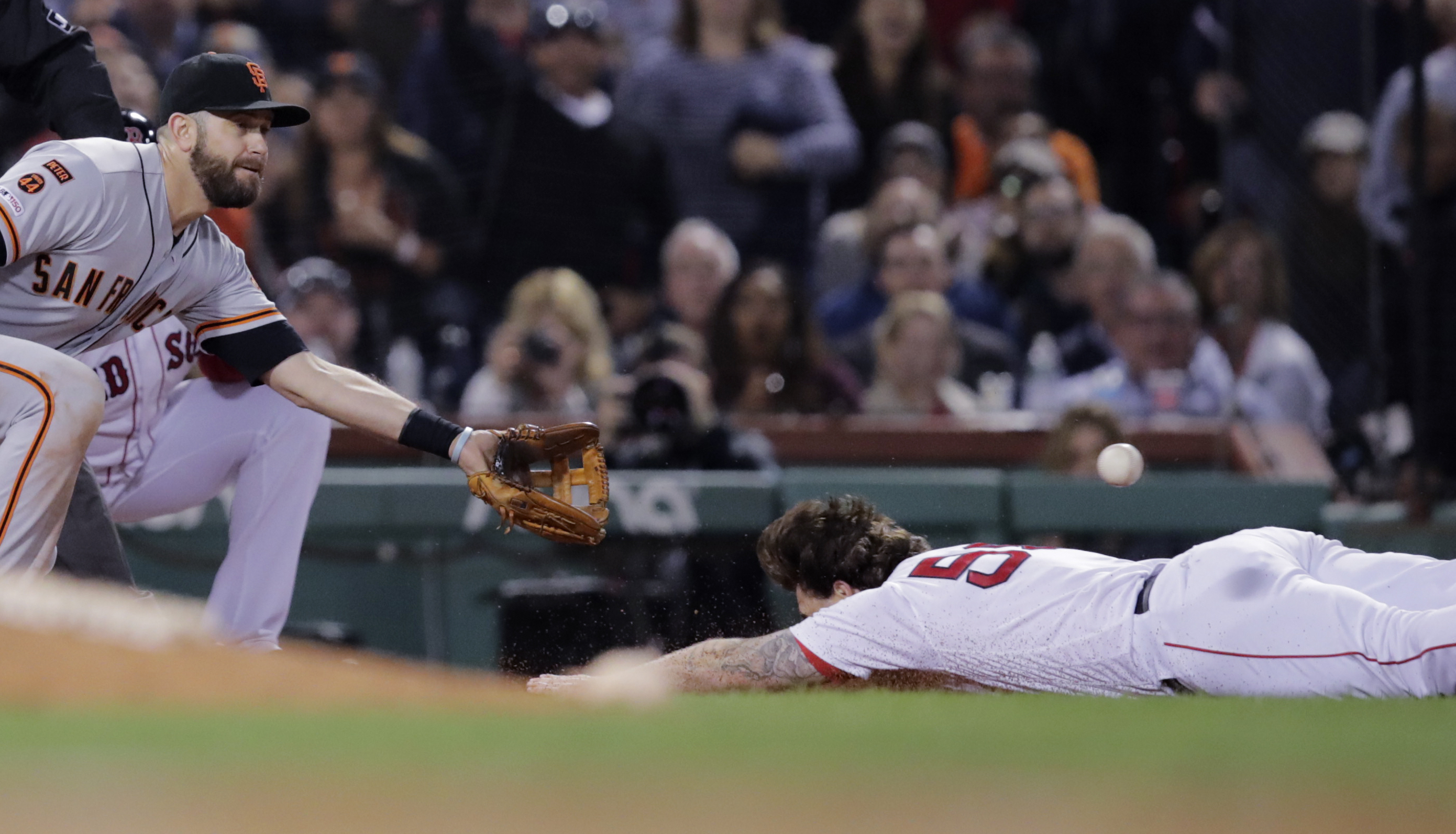 Sam Travis leaves Boston Red Sox game after relay throws strikes him in back of head while diving into third on triple
