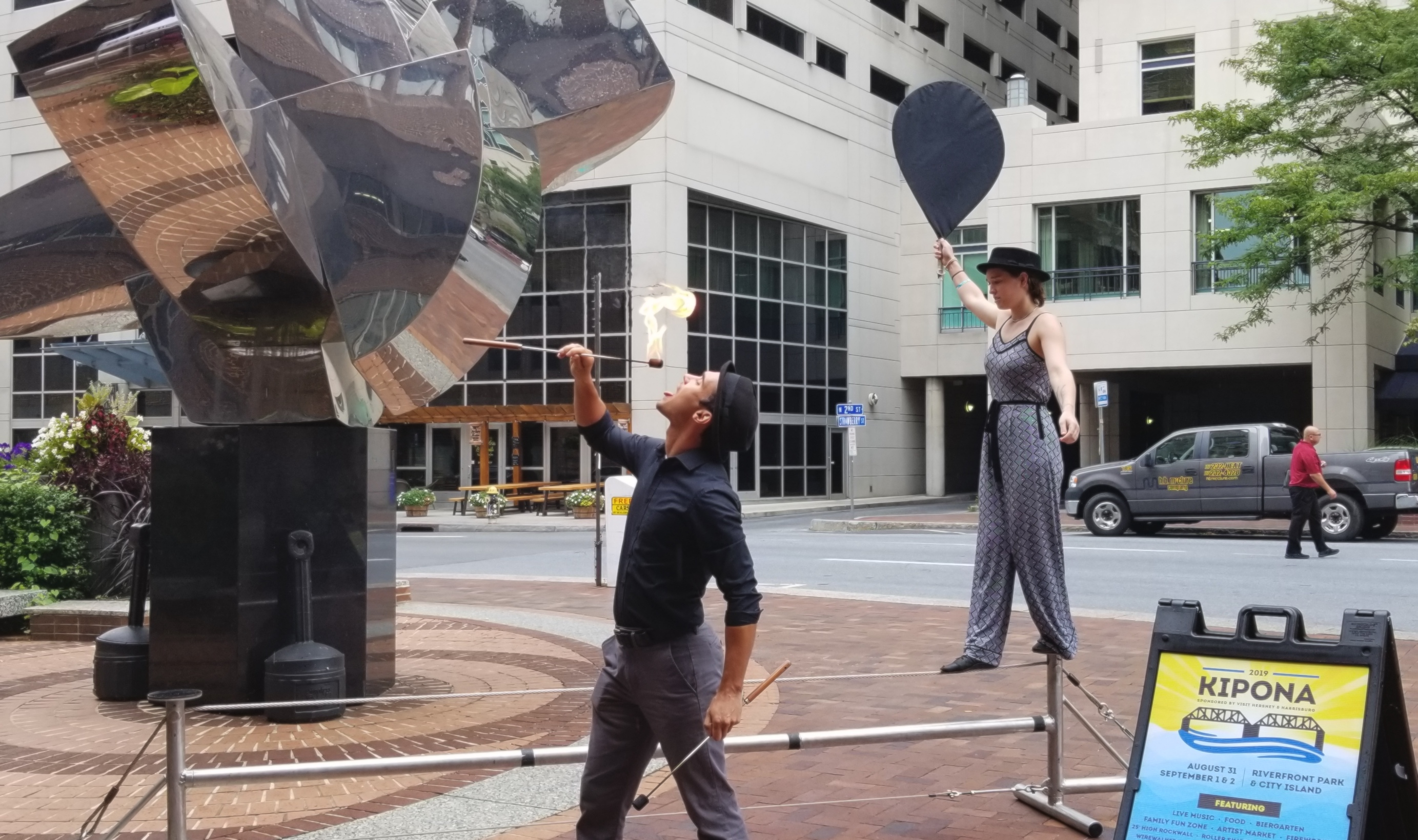 Fire breather, tightrope walker give preview of Kipona Festival outside of Harrisburg's government center