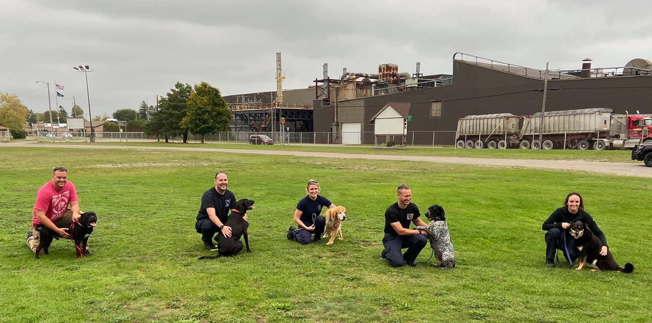 K9 officers pose for photos with 5 dogs left in Northern Michigan shelter