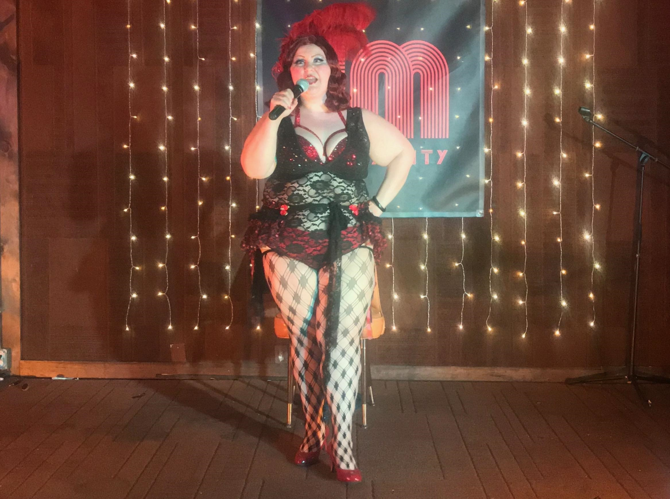 Queen of Jersey City burlesque cloaks serious message in feathers and fishnets