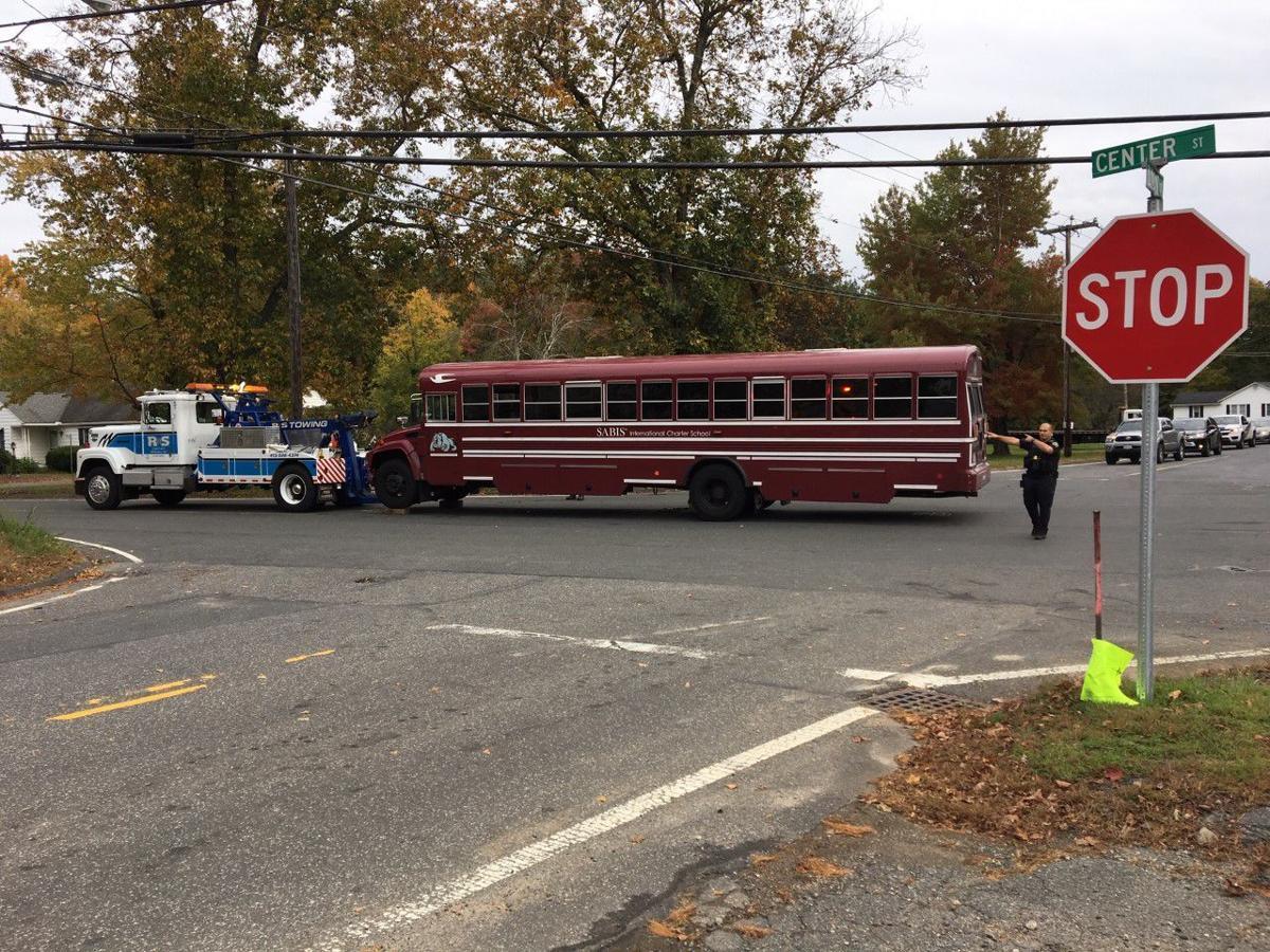 Motorist reportedly taken to hospital following school bus crash in Ludlow