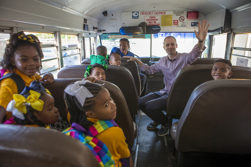 Lowrey Crews, an assistant principal at KIPP East Community Primary, sits on a bus as he greets returning students on the first day back at school in New Orleans on Monday, August 7, 2017.