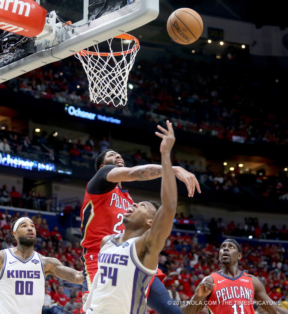 New Orleans Pelicans forward Anthony Davis (23) blocks a shot by Sacramento Kings guard Buddy Hield (24) during the home opener game between the Sacramento Kings and New Orleans Pelicans at the Smoothie King Center on Friday, October 19, 2018. (Photo by Michael DeMocker, NOLA.com | The Times-Picayune)