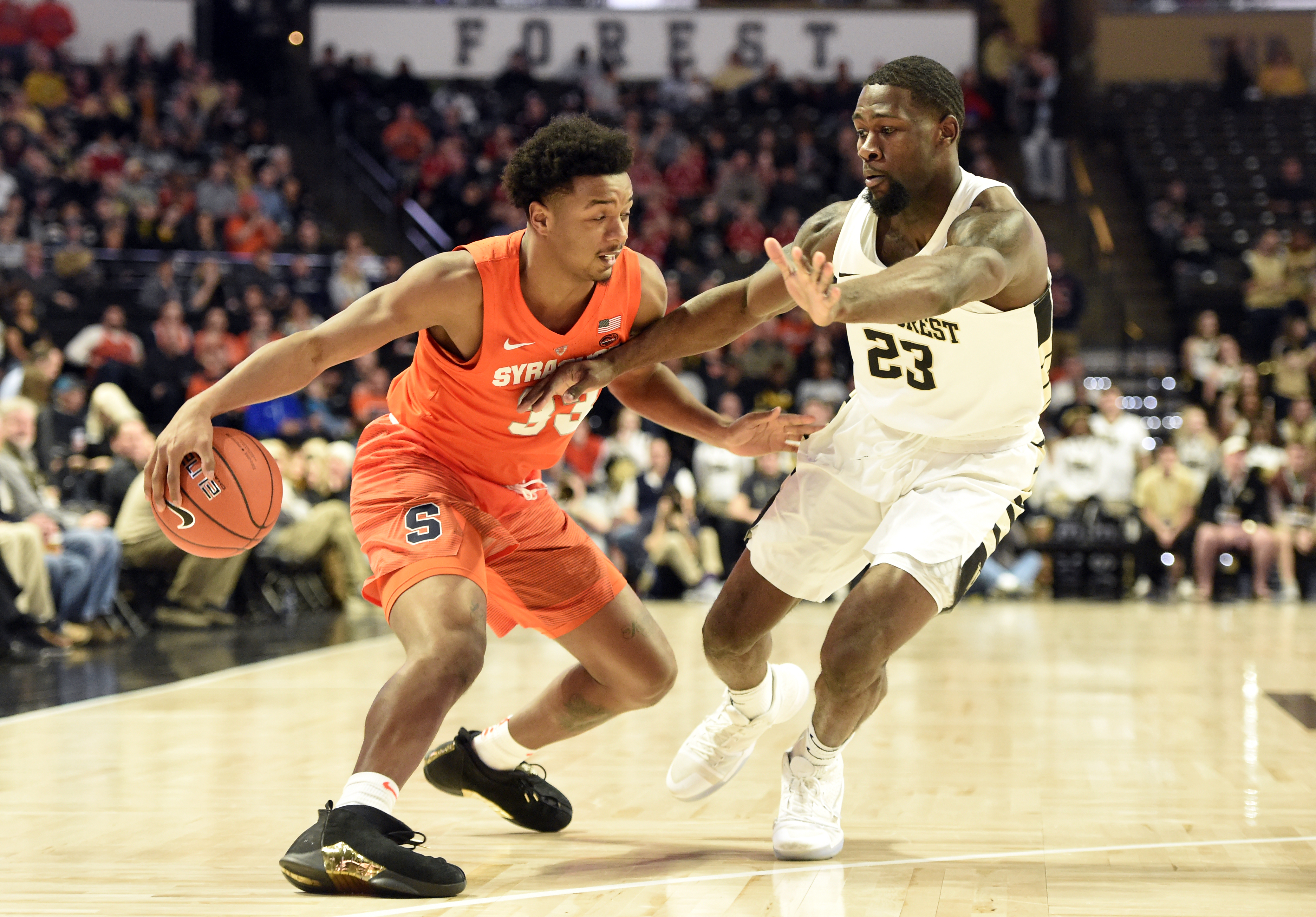 Elijah Hughes Drives Home Point Scores 18 In Syracuse
