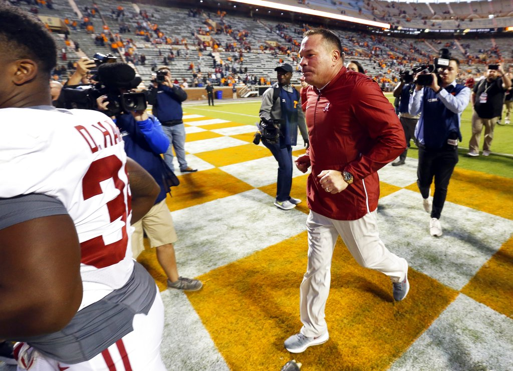 Former Tennessee head football coach Butch Jones leaves the field after an NCAA college football game against Tennessee Saturday, Oct. 20, 2018, in Knoxville, Tenn. Alabama won 58-21. (AP Photo/Wade Payne)