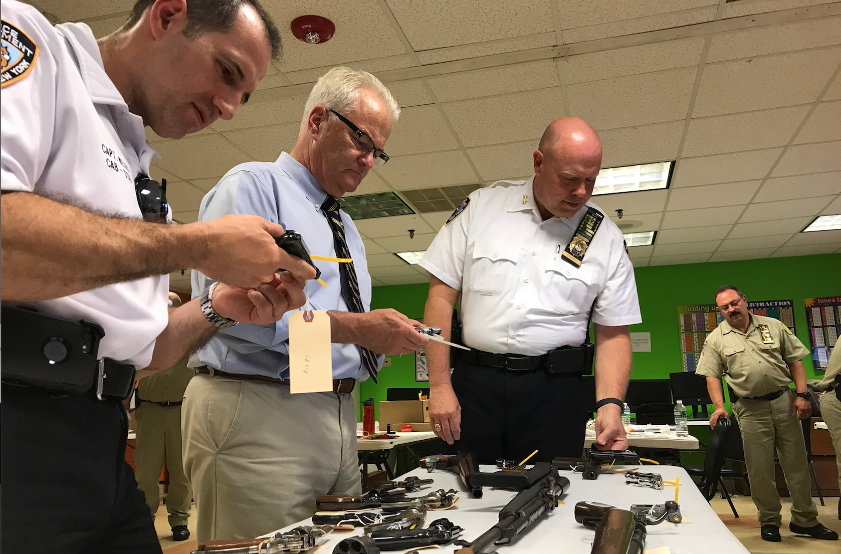 Dangerous haul of guns turned over to police, D.A. McMahon in 'Cash for Guns' initiative