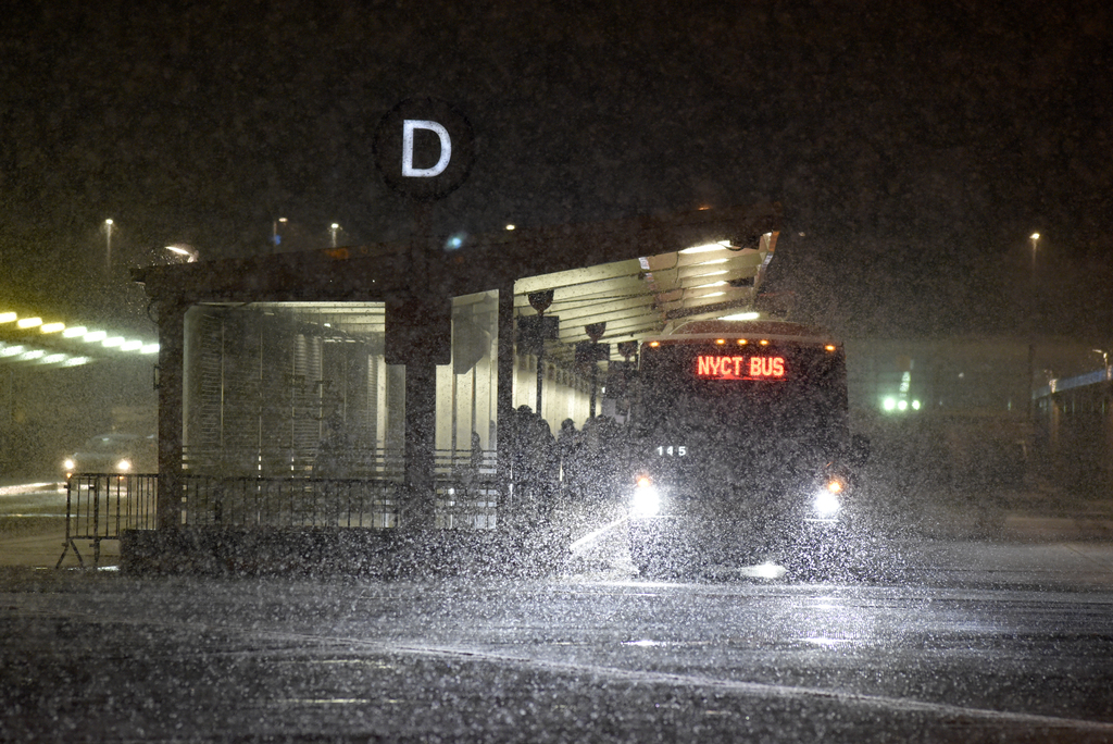 A bus arrives at the Staten Island Ferry terminal in St. George as a heavy snow falls Saturday, February 17, 2018. The MTA is considering reduced overnight bus service to the Staten Island Ferry. (Staten Island Advance/Bill Lyons)