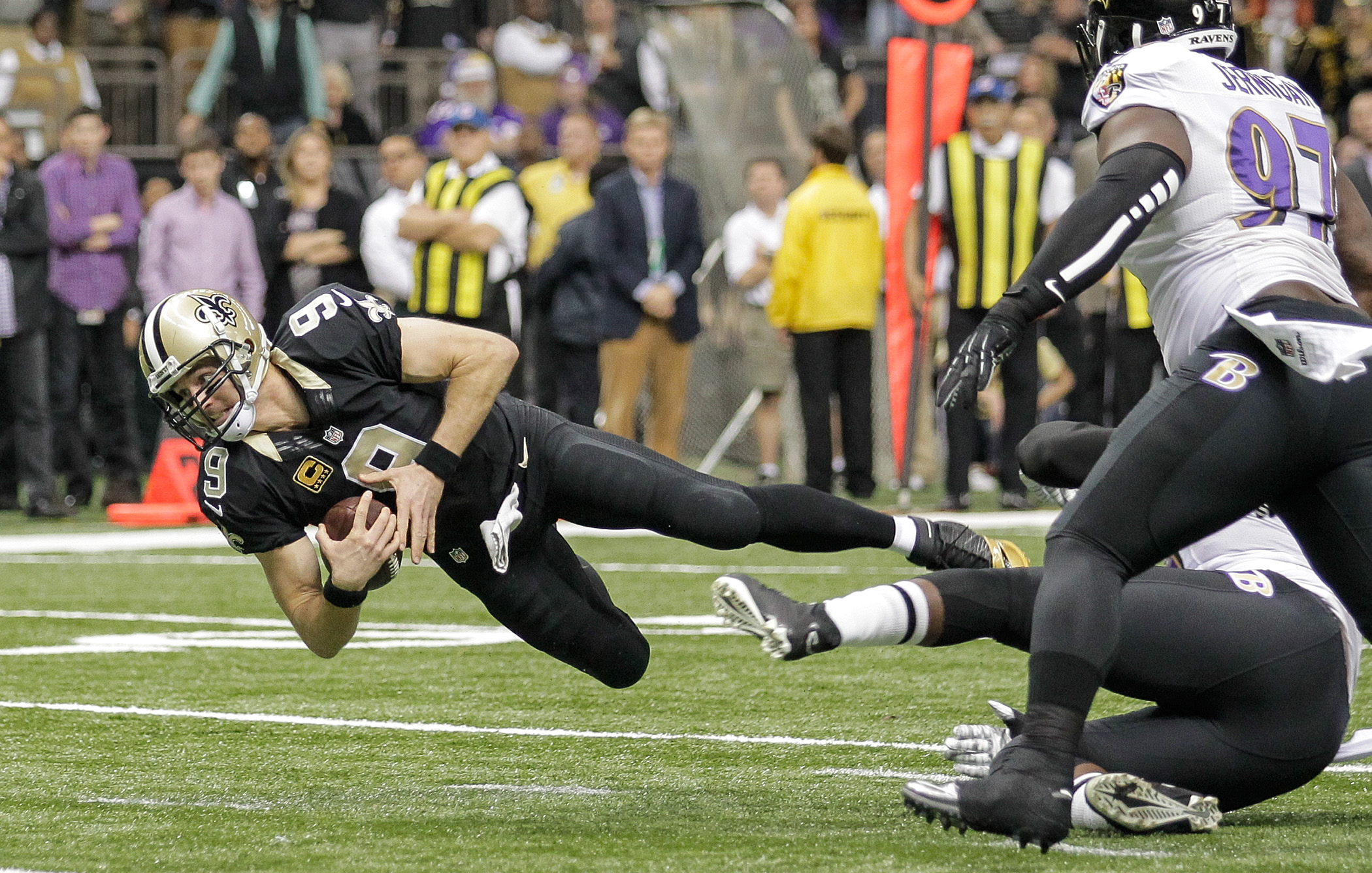 New Orleans Saints quarterback Drew Brees (9) scrambles towards the goal line but comes up short and the Saints come away with no points during the game at the Mercedes-Benz Superdome in New Orleans, Monday, November 24, 2014. (Photo by David Grunfeld, NOLA.com | The Times-Picayune)