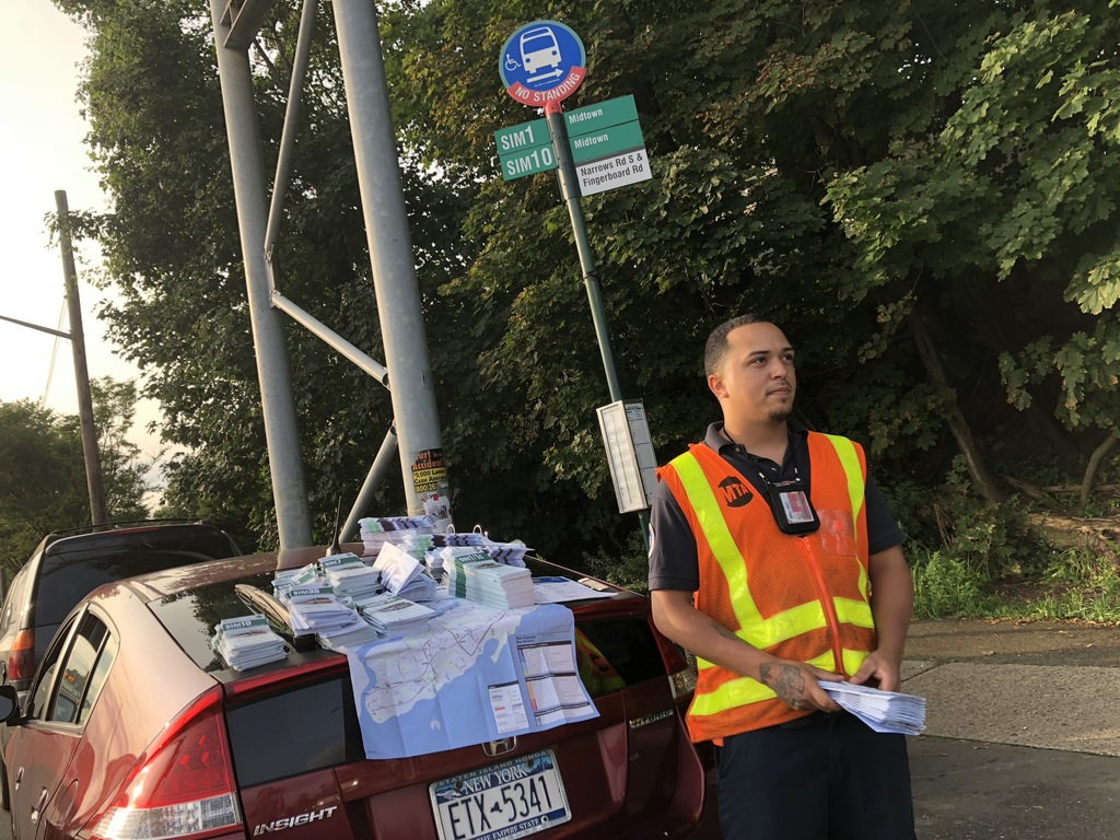 MTA staffer Timothy Cruz and other officials were on hand to offer information to commuters at the Narrows Road South express bus stop at Hylan Boulevard. (Staten Island Advance/Jan Somma-Hammel)