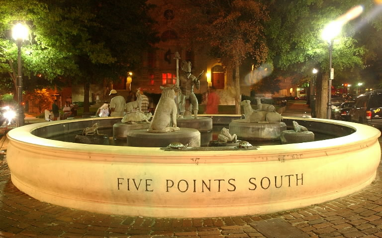 The fountain at Five Points South at night.