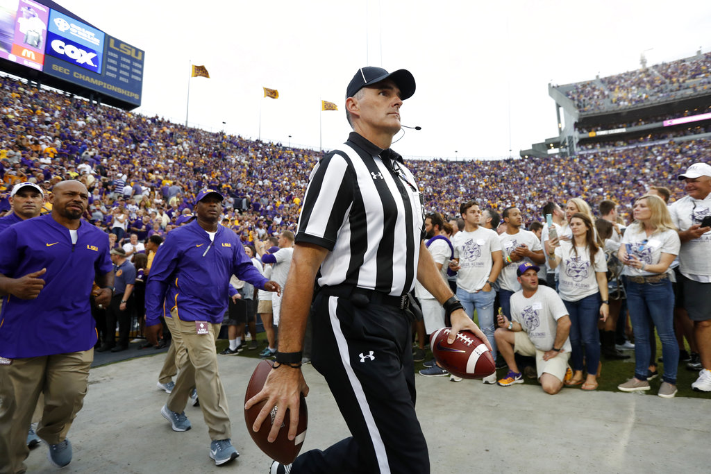 Official before an NCAA college football game in Baton Rouge, La., Saturday, Oct. 20, 2018. (AP Photo/Tyler Kaufman)