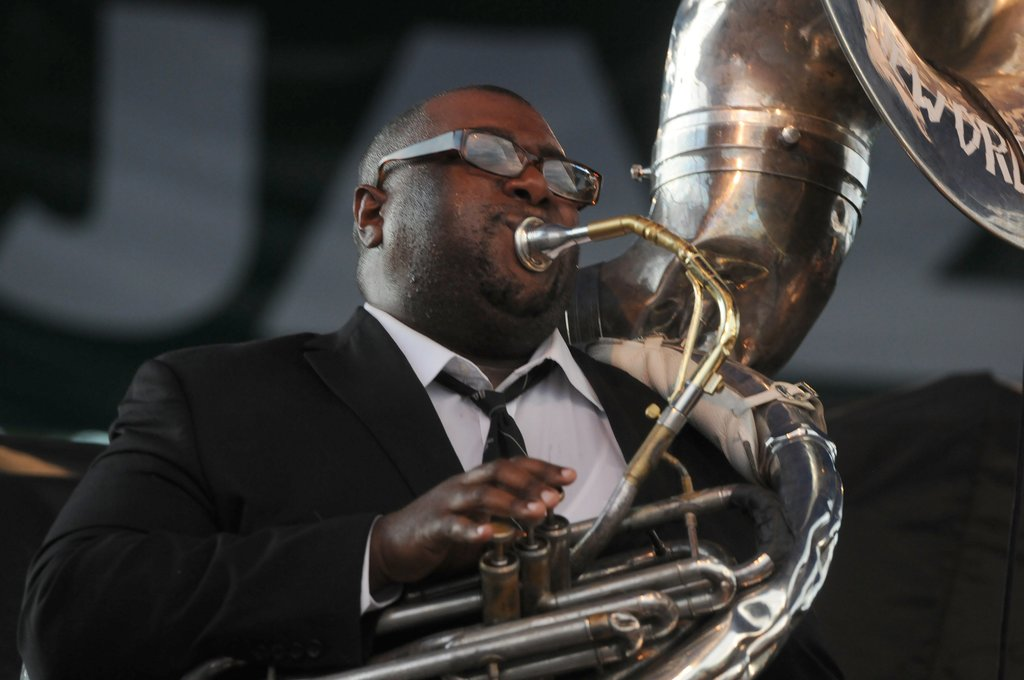 Tuba player Ronell Johnson performs with the Preservation Hall Jazz Band at the 2013 M&T Syracuse Jazz Fest at Jamesville Beach Park.