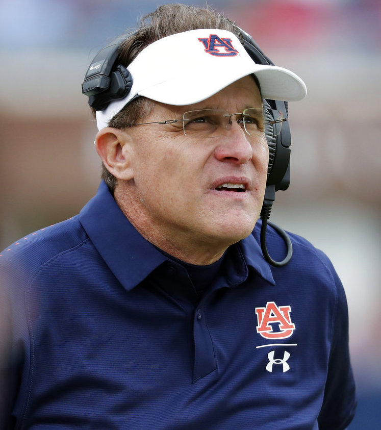 Auburn head coach Gus Malzahn watches a replay on a giant monitor during the second half of an NCAA college football game against Mississippi, Saturday, Oct. 20, 2018, in Oxford, Miss. Auburn won 31-16. (AP Photo/Rogelio V. Solis)