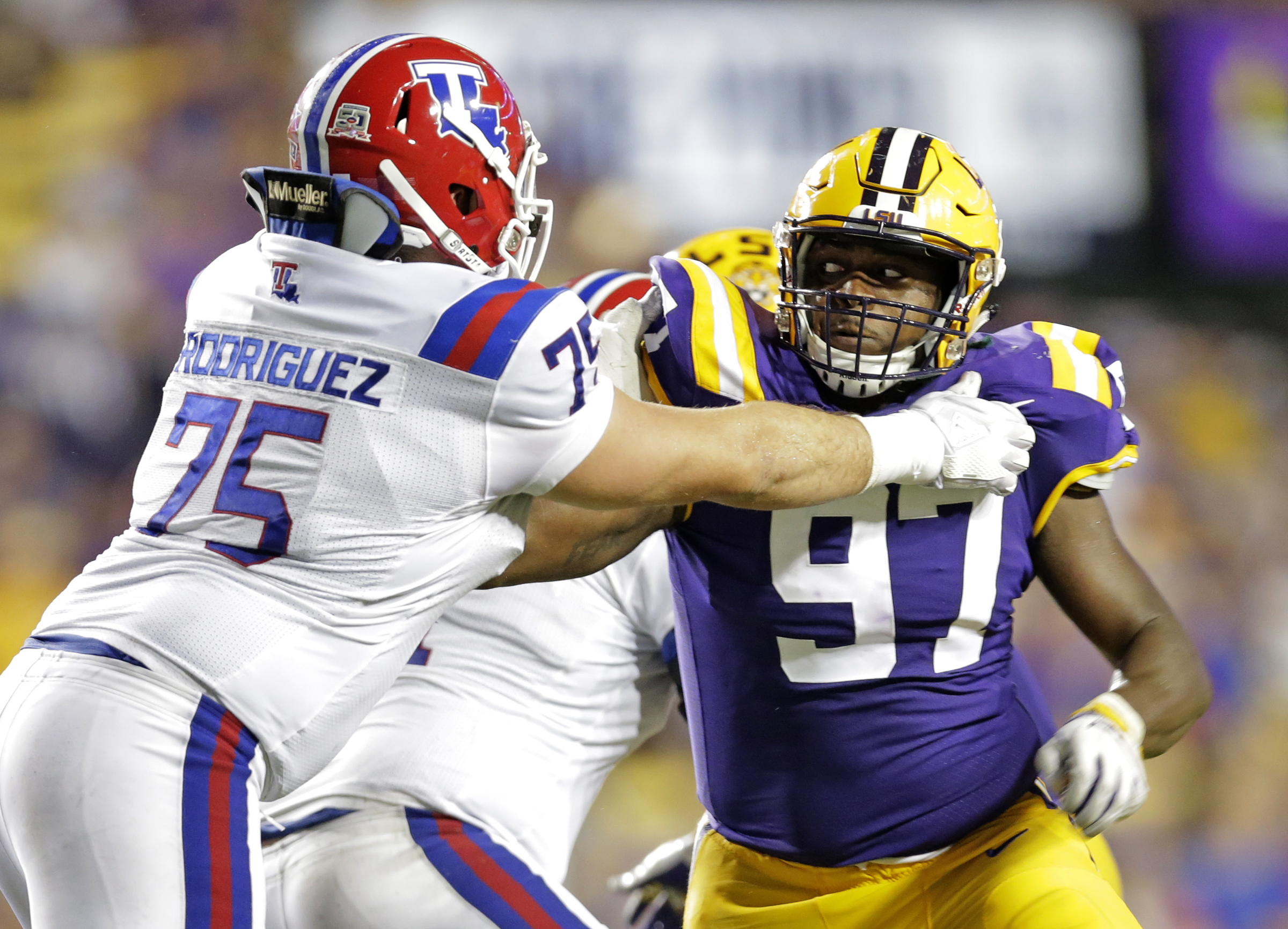 LSU Tigers defensive end Glen Logan (97) competes against Louisiana Tech Bulldogs offensive lineman Michael Rodriguez (75) during second half action in Baton Rouge on Saturday, September 22, 2018. The LSU Tigers defeated the Louisiana Tech Bulldogs 38-21. (Photo by Brett Duke, NOLA.com | The Times-Picayune) NOLA.com | The Times-Picayune