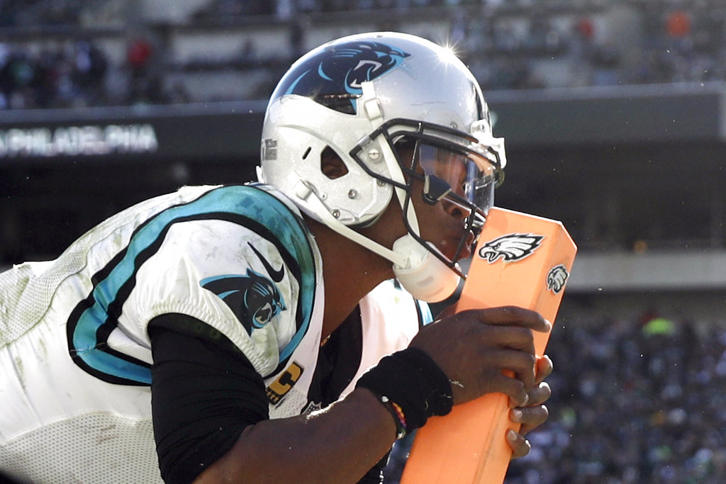 Carolina Panthers quarterback Cam Newton kisses a goal-line pylon after throwing a touchdown pass during an NFL game against the Philadelphia Eagles on Sunday, Oct. 21, 2018, at Lincoln Financial Field in Philadelphia.